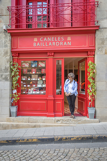 Mitzi waits in the doorway of a shop in St. Emilion, Bordeaux, France (Clark James Mishler)