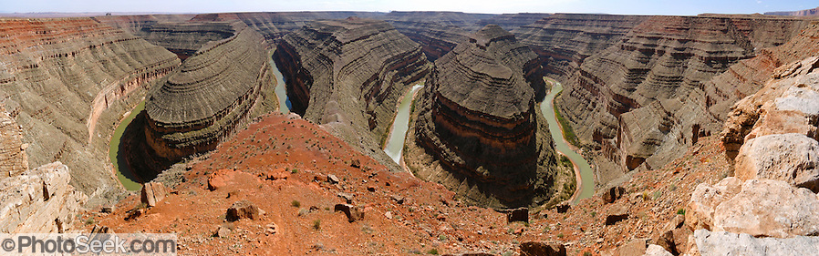 Goosenecks State Park overlooks a deep meander of the San Juan River near Mexican Hat, Utah, USA. Millions of years ago, the Monument Upwarp forced the river to carve meanders over 1,000 feet deep (300 m) as the surrounding landscape slowly rose in elevation. (Panorama stitched from 10 photos.) (© Tom Dempsey / Photoseek.com)