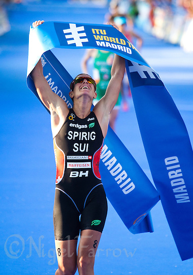 26 MAY 2012 - MADRID, ESP - Nicola Spirig (SUI) of Switzerland celebrates winning the elite women's 2012 World Triathlon Series round in Casa de Campo, Madrid, Spain .(PHOTO (C) 2012 NIGEL FARROW) (NIGEL FARROW/(C) 2012 NIGEL FARROW)
