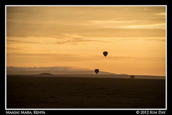 Silhouetted Balloons Against Orange Sunrise.Maasai Mara, Kenya.September 2012 (Kim Day)