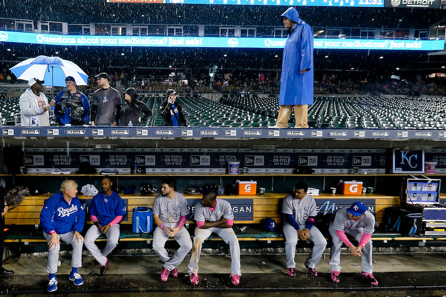 May 10, 2015; Detroit, MI, USA; Kansas City Royals first base coach Rusty Kuntz (left to right) Jarrod Dyson (1) first baseman Eric Hosmer (35) enter fielder Lorenzo Cain (6) and third baseman Christian Colon (24) sits in dugout during a rain delay in the ninth inning against the Detroit Tigers at Comerica Park. Mandatory Credit: Rick Osentoski-USA TODAY Sports (Rick Osentoski/Rick Osentoski-USA TODAY Sports)
