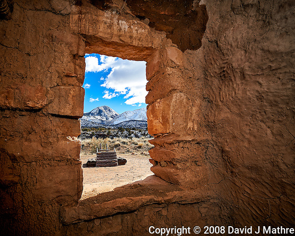 Window looking out at Sleeping Ute Mountain and wood ladder to the Kiva at Kelley's Place near Cortez, Colorado. Image taken with a Nikon D3 camera and 14-24 mm f/2.8 lens and interior fill flash (ISO 200, 16 mm, f/11, 1/250 sec). (David J Mathre)