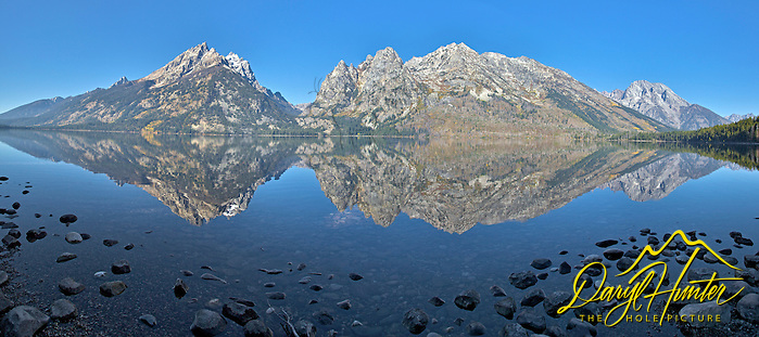 Jenny Lake Panorama, Grand Teton Mountain Reflections in the calm water of Jenny Lake in Grand Teton National Park. 
