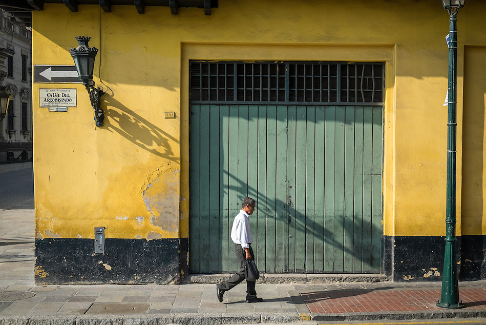 LIMA, PERU - CIRCA APRIL 2014: Man walking in Calle del Arzobispado in the Lima Historic Centre in Peru (Daniel Korzeniewski)