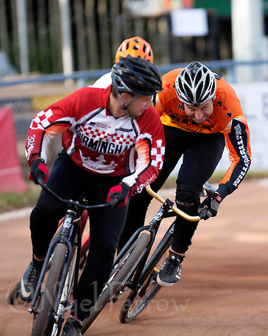 13 SEP 2014 - IPSWICH, GBR - Lee Aris (right) of Wednesfield Aces prepares to challenge Marcus Wadhams (left) of Birmingham Monarchs for the lead during a heat of the 2014 British Open Club Cycle Speedway Championship final at Whitton Sports & Community Centre in Ipswich, Great Britain (PHOTO COPYRIGHT © 2014 NIGEL FARROW, ALL RIGHTS RESERVED) (NIGEL FARROW/COPYRIGHT © 2014 NIGEL FARROW : www.nigelfarrow.com)