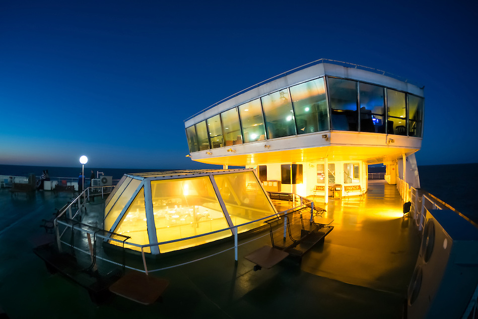 Night view of the deck of one the ferry boats that service the crossing of the Rio de La Plata, between Colonia del Sacaramento in Uruguay and Buenos Aires in Argentina. (Daniel Korzeniewski)