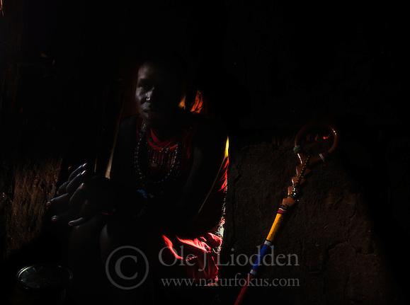 Masai boy inside hut in Masai Mara, Kenya (Ole Jørgen Liodden)