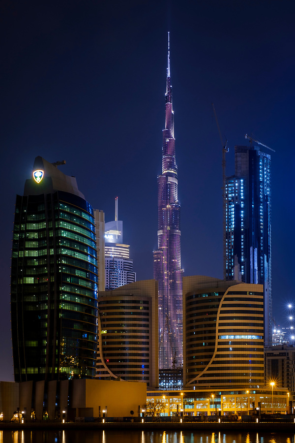 UNITED ARAB EMIRATES, DUBAI - CIRCA JANUARY 2017: View of the Burj Khalifa and the LED Light Show as seen from Business Bay in Dubai. The skyscraper is the tallest building of the world, an icon of the city and a very popular tourist attraction. (Daniel Korzeniewski)