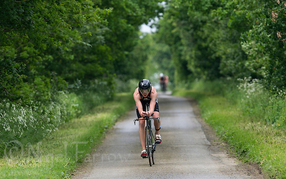 25 MAY 2014 - BRIGG, GBR - Tom Stead (GBR) of Great Britain cycles along a country lane during the World Quadrathlon Federation 2014 Middle Distance World Championships at the Brigg Bomber at Brigg in Lincolnshire, Great Britain (PHOTO COPYRIGHT © 2014 NIGEL FARROW, ALL RIGHTS RESERVED) (NIGEL FARROW/COPYRIGHT © 2014 NIGEL FARROW : www.nigelfarrow.com)