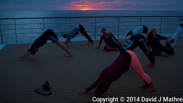 Yoga at Sunset on the Deck of the MV Explorer.  Image taken with a Leica X2 camera (ISO 100, 24 mm, f/3.5, 1/60 sec). Raw image processed with Capture One Pro, and Photoshop CC 2014. (David J Mathre)