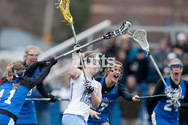 03/10/2012- Medford, Mass. - Tufts midfielder Emily Pillemer, A12, goes for a shot in Tufts 8-7 season opening win over Hamilton on Mar. 10, 2012. (Kelvin Ma/Tufts University)