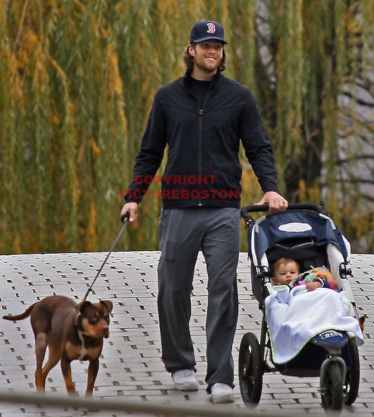 Tom Brady walks his dog Lua and his toddler Benjamin along the Charles River Tuesday afternoon, November 16,2010. Staff photo by Mark Garfinkel. (Mark Garfinkel/Boston  Herald)