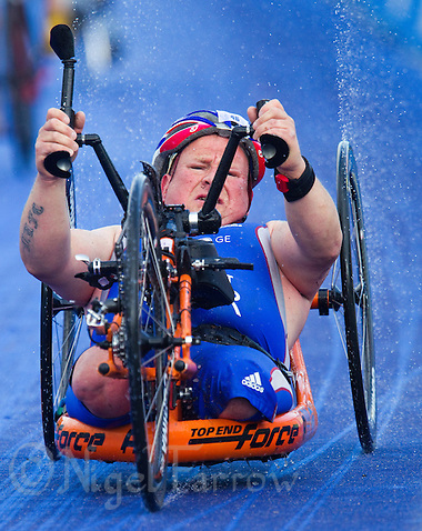 07 AUG 2011 - LONDON, GBR - Water sprays from the wheels of his hand bike as Alan Rayment (GBR) starts another lap during the TRI-1 category race during the paratriathlon at triathlon's ITU World Championship Series event (PHOTO (C) NIGEL FARROW) (NIGEL FARROW/(C) 2011 NIGEL FARROW)
