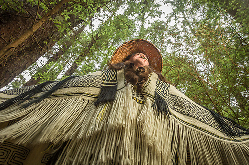 Jamie Bradly models her historic Raven's Tail Robe and Cedar Bark Hat at Sitka Historic National park  in Sitka, Alaska (Clark James Mishler)