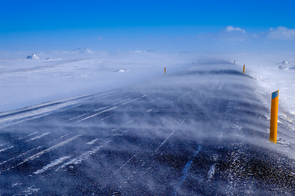 "MÝVATN, ICELAND - CIRCA MARCH 2015: Gale winds over the Route 1 in winter tme, also called ""The Ring"" close to Mývatn in Iceland. (Daniel Korzeniewski)"
