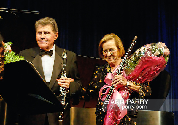 MERRICK - NOV. 13: Stanley Drucker, clarinetist; with (R) wife Naomic Drucker, with bouquet of flowers during curtain call after performing in concert presented by Merrick-Bellmore Community Concert Association, November 13, 2010, in Merrick, NY, USA (Ann Parry/Ann Parry, Ann-Parry.com)