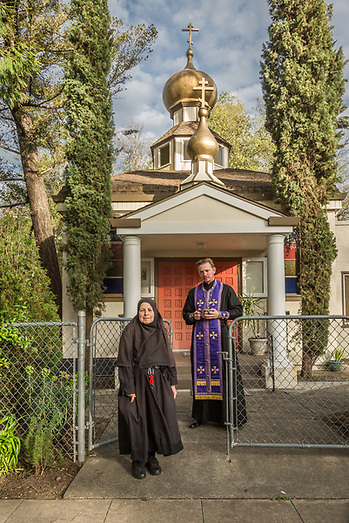Mother Tabitha and Father Vladimir stand in front of the Saint Simeon Russian Orthodox Church in Calistoga (Clark James Mishler)