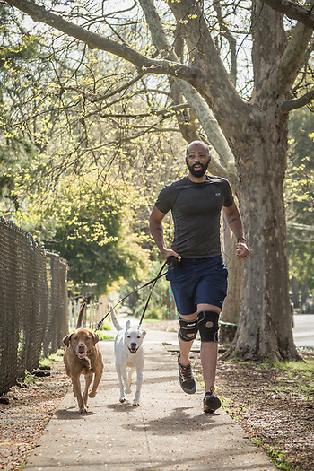 Ian  Brooks runs with his rescue dogs on Cedar Street in Calistoga (Clark James Mishler)