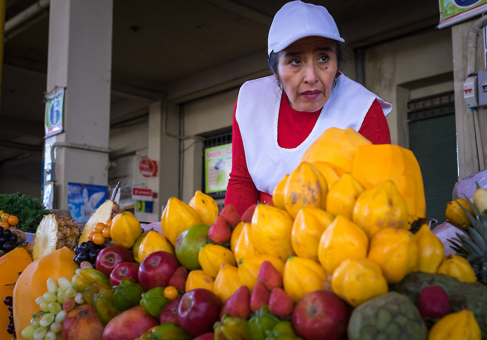 AREQUIPA, PERU - CIRCA APRIL 2014: Merchant in one of the juice stalls at the San Camilo market in Arequipa. Arequipa is the Second city of Perú by population with 861,145 inhabitants and is the second most industrialized and commercial city of Peru. (Daniel Korzeniewski)