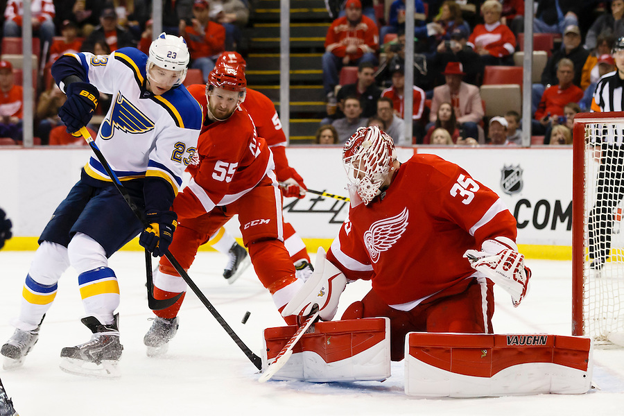 Mar 22, 2015; Detroit, MI, USA; Detroit Red Wings goalie Jimmy Howard (35) makes a save on St. Louis Blues right wing Dmitrij Jaskin (23) in the second period at Joe Louis Arena. Mandatory Credit: Rick Osentoski-USA TODAY Sports (Rick Osentoski/Rick Osentoski-USA TODAY Sports)