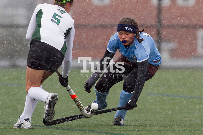 11/07/2012 - Medford, Mass. - Tufts midfielder/defenseman Alexandra Jamison, A16, stuffs a Castleton attacker in Tufts' 8-0 win in the first round of the NCAA Championships at Bello Field on Nov. 7, 2012. (Kelvin Ma/Tufts University)