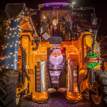 Karen Trejo opperates an Oxbow 6120 Grape Harvester just before the start of the Calistoga Lighted Tractor Parade vic1trejo@gmail.com (© Clark James Mishler)