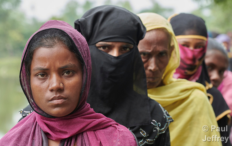 Rohingya refugee women line up to receive food from ICCO Cooperation in the Chakmarkul Refugee Camp near Cox's Bazar, Bangladesh, where ICCO and other members of the ACT Alliance provide a variety of humanitarian support for the refugees. More than 600,000 Rohingya have fled government-sanctioned violence in Myanmar for safety in Bangladesh. (Paul Jeffrey)