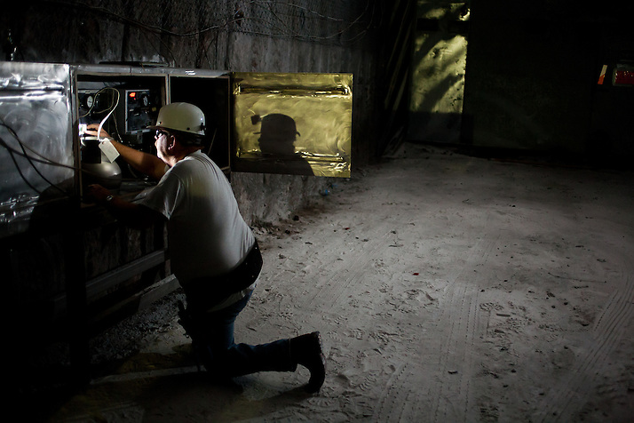 A worker checks electronics systems by headlamp 2150 ft underground inside The Waste Isolation Pilot Plant in Eddy County. WIPP received $172 million as part of the Recovery and Reinvestment Act accelerate nuclear waste cleanup. (Steven St. John)