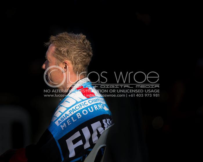 Age Group Competitor in Recovery, March 23, 2014 - Ironman Triathlon : Ironman Melbourne Race, Run Course Run Course Race Finish, St Kilda, Melbourne, Victoria, Australia. Credit: Lucas Wroe (Lucas Wroe)