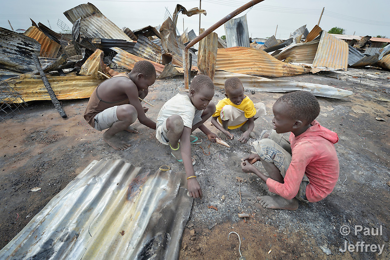 Children look for valuable items in the ashes of what was once the central market in Bor, a city in South Sudan's Jonglei State that has been the scene of fierce fighting in recent months between the country's military and anti-government rebels. After fighting broke out in mid December 2013, control of the town changed hands four times in a few weeks. ACT Alliance members were among the first humanitarian agencies to enter the city in January 2014, and are providing services to thousands of people who are cautiously returning home to the troubled city. (Paul Jeffrey)