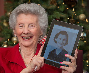 """Florence Waters Schillaci, 95, displays her photo from the 1936 Milby High School yearbook """"The Buffalo"""" on a tablet at her home, December 17, 2013. Milby students have been digitizing past copies of the yearbook for a class project. (HISD/Dave Einsel)"""