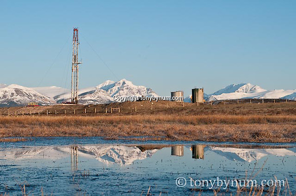 drill rigs set up to frack oil on the blackfeet reservation with rising wolf mountain glacier national park, montana, usa  the background (Tony Bynum/tonybynum.com)