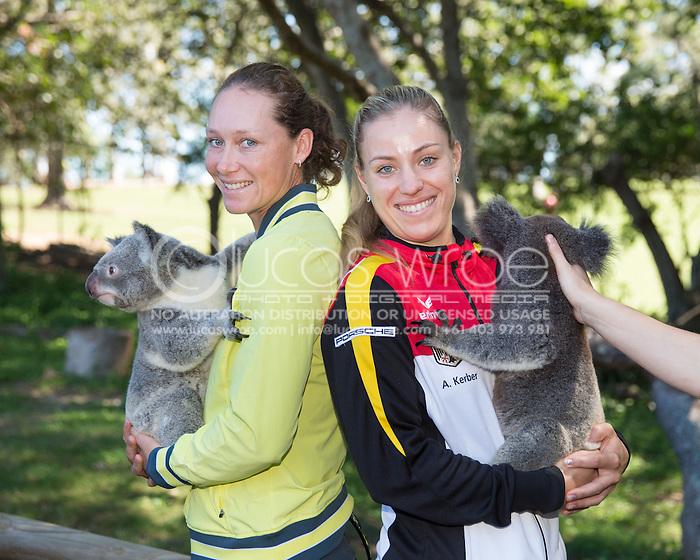 Samantha Stosur (AUS) and Angelique Kerber (GER), April 18, 2014 - TENNIS : Fed Cup, Semi-Final, Australia v Germany. Lone Pine Koala Sanctuary, Brisbane, Queensland, Australia. Credit: Lucas Wroe (Lucas Wroe)