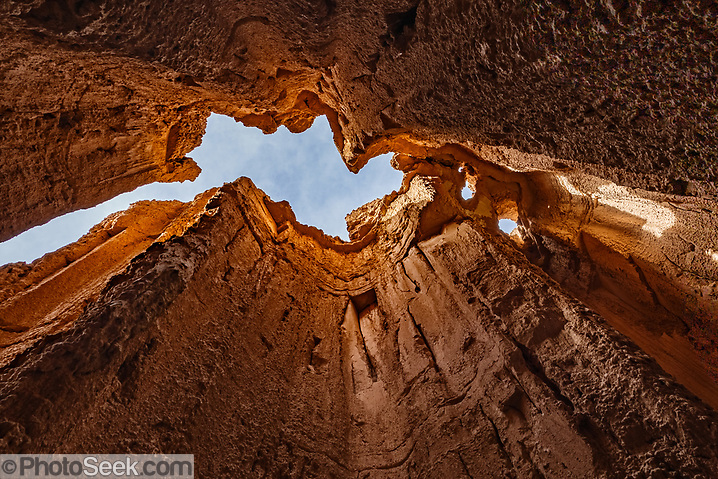 Inside a slot canyon at the Moon Caves in Cathedral Gorge State Park, Panaca, Nevada, USA. Million-year-old lake sediments have eroded into fantastic mud castles at Cathedral Gorge State Park. This image was HDR-stitched from two photos to increase the dynamic range from light to dark with low noise. (© Tom Dempsey / PhotoSeek.com)