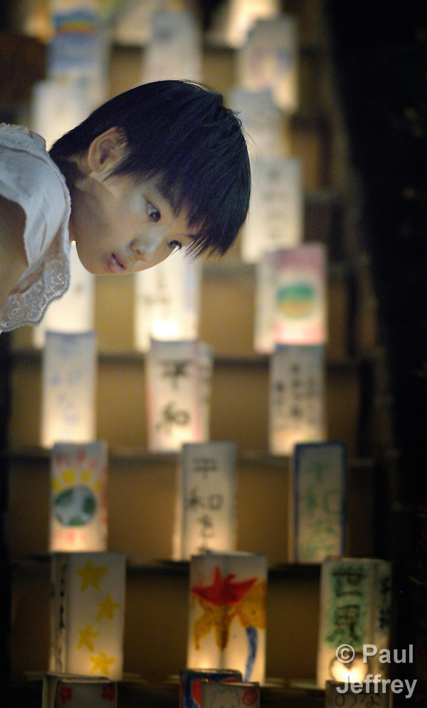 A girl inspects candles lining a path in Nagasaki, Japan, on August 8, 2015, the eve of the 70th anniversary of the U.S. bombing of the port city with an atomic bomb. The candles represent a memorial to those who died and a prayer for peace, including an end to nuclear weapons. (Paul Jeffrey)