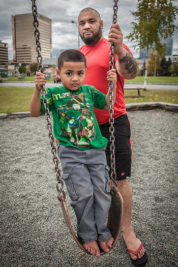 Tim Opetaia and his son, Deuteronomy at Frontier Park in Anchorage's South Addition Neighborhood.  Isrole@yahoo.com (© Clark James Mishler)