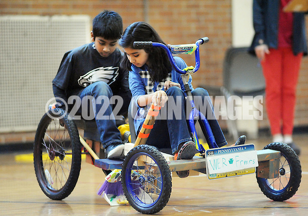 SODYSSEY28P From left, Thomas Cherian and Heeya Jagirdar of Afton Elementary School ride on a tricycle the demonstrations their solution to No-Cycle Recycle during the Southeast Pennsylvania Odyssey of the Mind tournament Saturday February 27, 2016 at Pennsbury High School West in Fairless Hills, Pennsylvania. (William Thomas Cain/For The Inquirer) (William Thomas Cain/Cain Images)