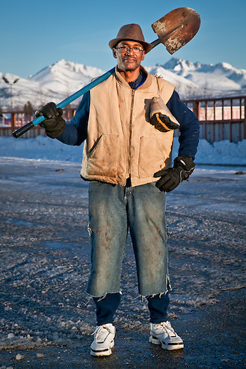 Roof shoveler, landscaper, Painter, and handyman, Jack David, on his way home in the parking lot of Chugach Elementary School, Anchorage. (Clark James Mishler)
