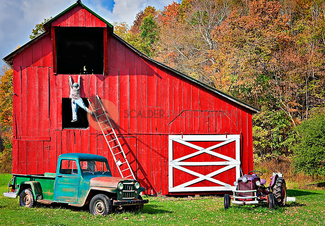 Bright red barn with antique car and tractor, with lifesize figure falling off a ladder in front of Sharp's Country Store, Slatyfork, West Virginia (sandra calderbank)