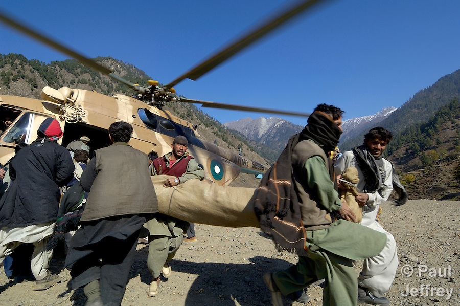 Following an October 8, 2005, earthquake in northern Pakistan, Church World Service/Action by Churches Together responded quickly to the needs of thousands of affected families. Here a Pakistan Army helicopter is used to ferry relief supplies provided by CWS/ACT to the remote village of Gantar.