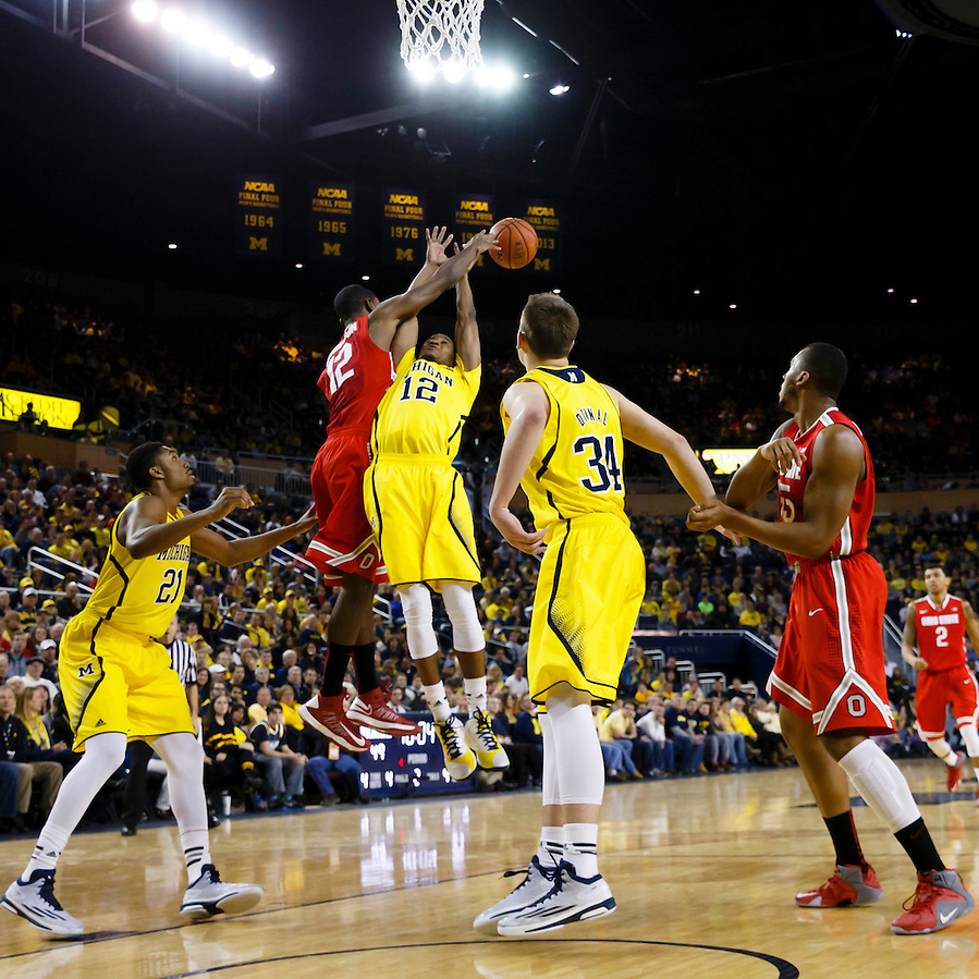 Feb 22, 2015; Ann Arbor, MI, USA; Ohio State Buckeyes forward Sam Thompson (12) knocks the ball back on the rebound over Michigan Wolverines guard Muhammad-Ali Abdur-Rahkman (12) in the second half at Crisler Center. Michigan won 64-57. Mandatory Credit: Rick Osentoski-USA TODAY Sports (Rick Osentoski/Rick Osentoski-USA TODAY Sports)