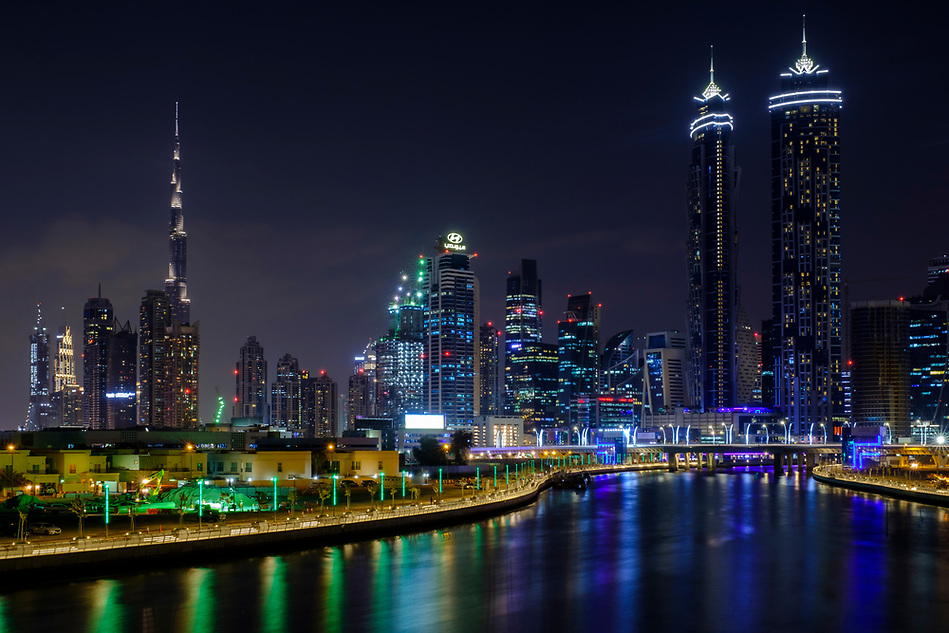 UNITED ARAB EMIRATES, DUBAI - CIRCA JANUARY 2017: The Dubai water canal at night with view of Downtown Dubai and the Burj Khalifa (Daniel Korzeniewski)