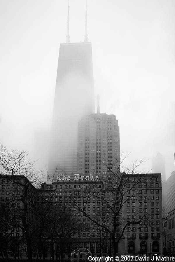 The Drake and John Hancock Tower in the Fog. Spring in Chicago. Image taken with a Nikon D200 and 18-200 mm VR lens (ISO 400, 18 mm, f/7.1, 1/200 sec). Raw image processed with Capture One Pro 7. (David J Mathre)