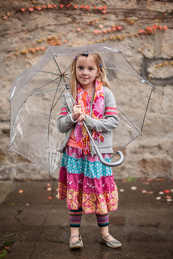 Five year old Ella Fitzpatrick, returning from a visit to her grandmother's house on a rainy day in Saint Helena, CA (© Clark James Mishler)