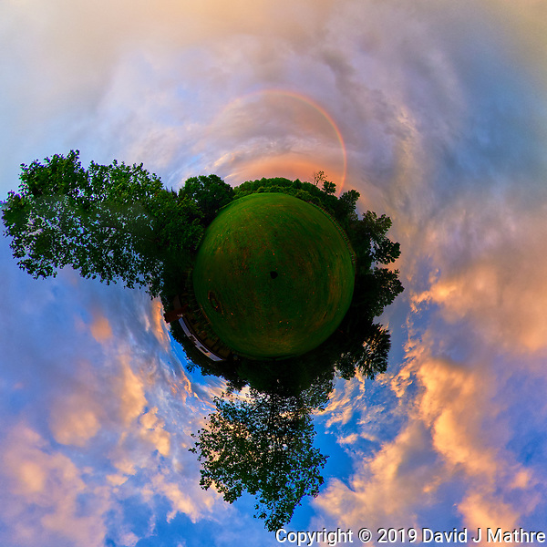 Little Planet View of an Evening Rainbow. After the Thunderstorm. Composite of 46 images taken with a Nikon D810a camera and 8-15 mm fisheye lens (ISO 200, 8 mm, f/8, 1/200 sec). Raw images processed with Capture One Pro and AutoPano Giga. (DAVID J MATHRE)