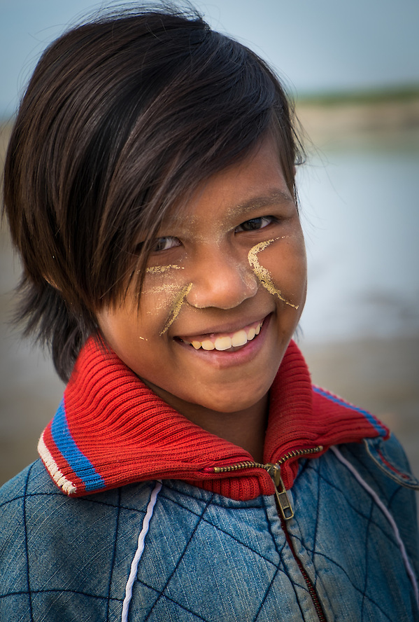 BAGAN, MYANMAR - CIRCA DECEMBER 2013: Portrait of young Burmese girl smiling in Bagan (Daniel Korzeniewski)