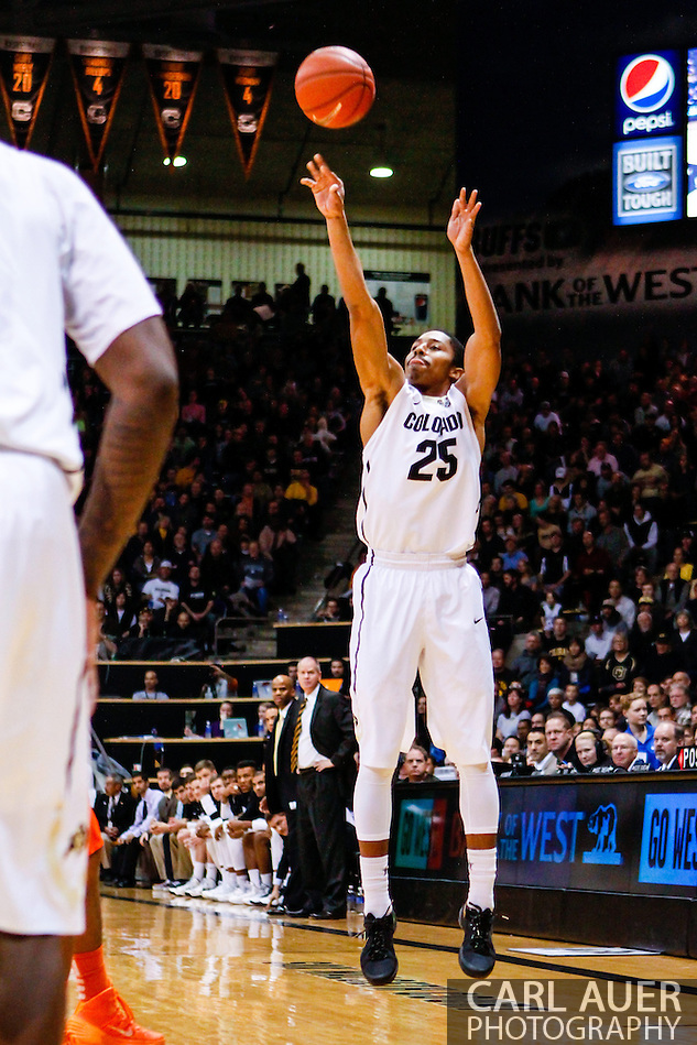 January 2nd, 2014:  Colorado Buffaloes junior guard Spencer Dinwiddie (25) attempts a three point shot in the first half of the NCAA Basketball game between the Oregon State Beavers and the University of Colorado Buffaloes at the Coors Events Center in Boulder, Colorado (Carl Auer/ZUMAPRESS.com)