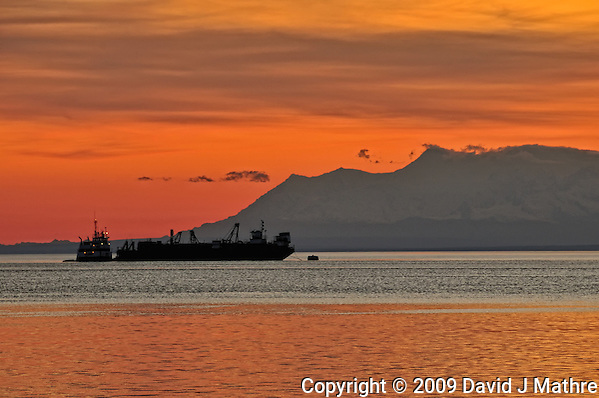 Silhouette of a Tug and Ship at Dusk in the Anchorage Harbor. Image taken with a Nikon D300 and 18-200 mm VR lens (ISO 200, 200 mm, f/11, 1/50 sec). Nikonians ANPAT-9 (David J. Mathre)
