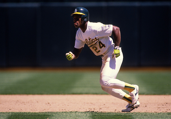 OAKLAND, CA-UNDATED:  Hall of Famer Ricky Henderson of the Oakland Athletics runs the bases at the Oakland Coliseum.    (Photo by Ron Vesely) (Ron Vesely)