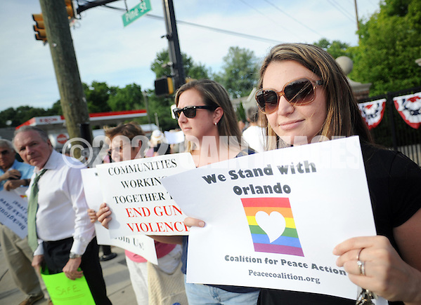 Sarah Grissell, right, of Bensalem, Pennsylvania and a group of supporters of the victims of the Orlando massacre hold signs at Pine and Maple Avenues Wednesday, June 15, 2016 in Langhorne, Pennsylvania. (Photo by William Thomas Cain) (William Thomas Cain)
